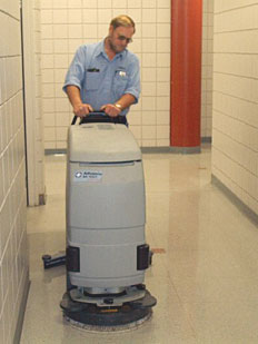 Custodian cleaning floor