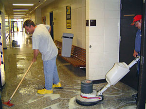 Custodians cleaning floors