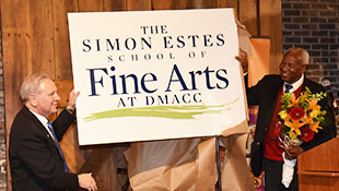 President Rob Denson and Dr. Simon Estes holding up sign that reads The Simon Estes School of Fine Arts at DMACC