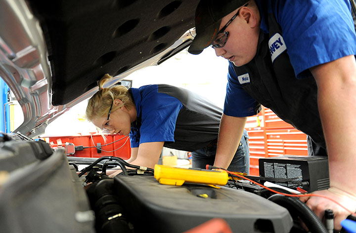 DMACC Ford ASSET students working under car