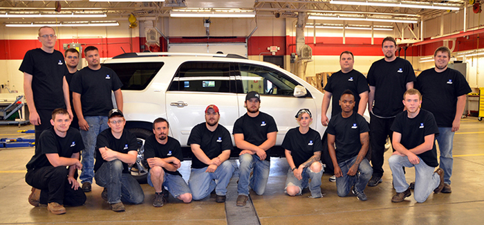 DMACC students with new GM Acadia car donated by General Motors