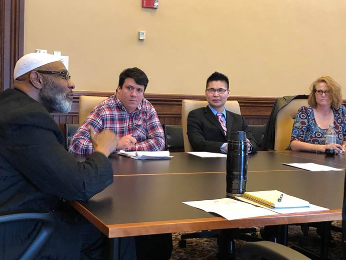 Students visit with state representative at a table