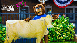 DMACC bear with the butter cow statue